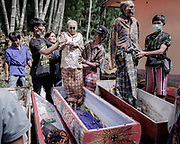 Dongga, who died in 2006 at age 78 and his wife, Sattu, who died in 2012 at age 80.<br /> <br /> Ma'nene is a tradition that takes place in August after harvest where the bodies of the dead loved ones are exhumed to be cleaned, groomed and dressed. For most, it's a bittersweet moment, a chance to reunite and physically see and touch and reconnect with loved ones who had passed on.