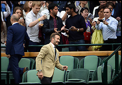 Image ©Licensed to i-Images Picture Agency. 28/06/2014, Wimbledon, London, United Kingdom. David Beckham posing with fans in the  Royal box on Day 6 of the Wimbledon Tennis Championship. Picture by Andrew Parsons / i-Images