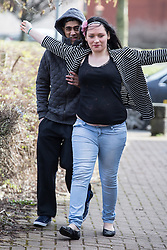 © Licensed to London News Pictures . 03/03/2015 . Bury , UK . SHAYFUR RAHMAN (l) pictured arriving with a woman . Iklaq Choudhry Hussain (37), Shayfur Rahman (31), Mohammed Davood (37), Rehan Ali (26) and Kutab Miah (34) are amongst ten men charged in relation to the investigation of child sexual exploitation in Rochdale appearing before Bury Magistrates' Court today (Tuesday 3rd March 2015) . Photo credit : Joel Goodman/LNP
