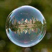 These amazing shots of world famous landmarks are captured through reflection of giant bubbles.<br /> <br /> They say the world is in a bubble, and ace photographer Tom Storm has proved it.These amazing shots of world famous landmarks are captured in a very unusual way  in the oily reflecting of giant bubbles.Tom, from Pennsylvania, said: I wanted people to see the world in a different perspective. The bubble is a shape that is so common around the world and I wanted to see what the world looked like on the side of a bubble. In themselves, they are fleeting, fantastic, and even other-worldly yet so familiar to us all. We can look closely and find momentary reflections, small worlds within these floating orbs that too quickly pass away, never to be seen again. Unless you have a camera. While I was enjoying a street fair in Galway, Ireland in the summer of 2006, bubbles from a nearby vendor floated past me. I saw a reflection in the spheres and quickly took a few shots and moved onto other subjects. When I returned from my trip and reviewed these shots closely I found a whole world in perfect focus. Since that moment I now carry bubble solution with me when I travel. He has been known to pull in crowds watching him take the shots after reeling in friends or even strangers on the spot to actually blow the bubbles. Tom said: People watch and stare as I follow these floating bubbles around with my camera pressed to my eye. Crowds form, and my bubble blowing partners who are either friends or willing strangers do their part to help make sure I dont wander into traffic, for example, while in Times Square in New York City, or into the random passersby. Its photography and is also a great social experiment. Its a show. Its all Natural. No digital manipulation of the bubbles aside from cropping and exposure adjustment. They are all as shot. It takes time, patience, teamwork, and a light-hearted approach. The very act of capturing these reflections is a meditation on virtue. Next on his l