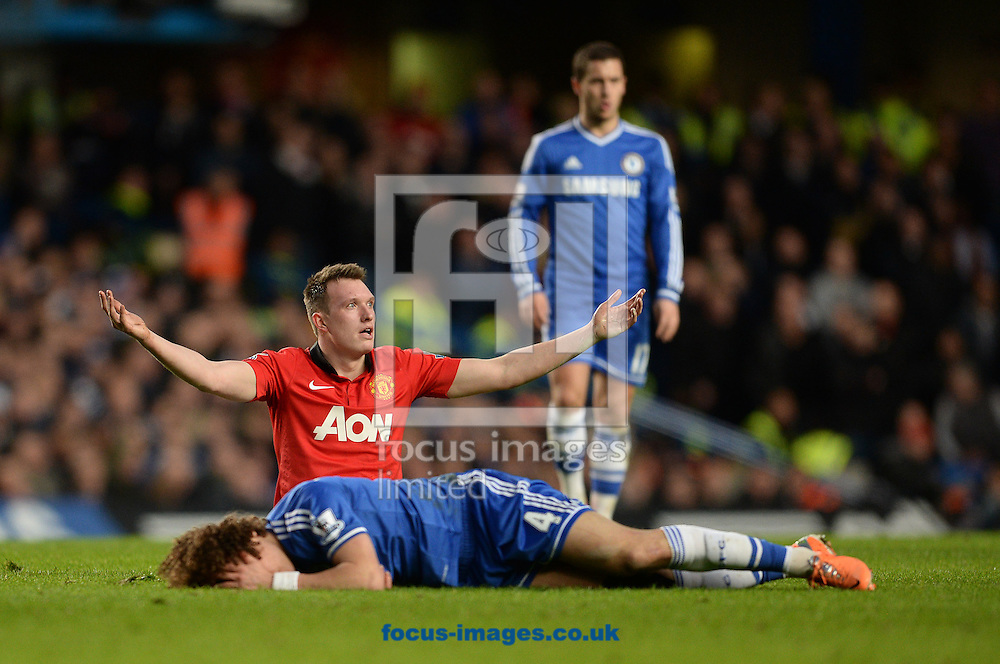 Picture by Andrew Timms/Focus Images Ltd +44 7917 236526<br /> 19/01/2014<br /> David Luiz of Chelsea and Phil Jones of Manchester United during the Barclays Premier League match at Stamford Bridge, London.