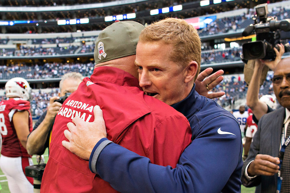 ARLINGTON, TX - NOVEMBER 2:  Head Coach Jason Garrett of the Dallas Cowboys and Head Coach Bruce Arians of the Arizona Cardinals hug after the game at AT&T Stadium on November 2, 2014 in Arlington, Texas.  The Cardinals defeated the Cowboys 28-17.  (Photo by Wesley Hitt/Getty Images) *** Local Caption *** Jason Garrett; Bruce Arians