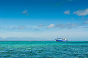 Fishing boat in the turquoise waters of the blue lagoon, Yasawas, Fiji, South Pacific