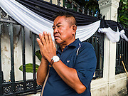 20 OCTOBER 2016 - BANGKOK, THAILAND:   A man prays for the late Bhumibol Adulyadej, the King of Thailand, on Sanam Luang in Bangkok. The King died Oct. 13, 2016. He was 88. His death came after a period of failing health. Bhumibol Adulyadej was born in Cambridge, MA, on 5 December 1927. He was the ninth monarch of Thailand from the Chakri Dynasty and is also known as Rama IX. He became King on June 9, 1946 and served as King of Thailand for 70 years, 126 days. He was, at the time of his death, the world's longest-serving head of state and the longest-reigning monarch in Thai history.     PHOTO BY JACK KURTZ