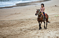 horse riding on songlanshan beach in the later afternoon.
