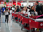 "25 NOVEMBER 2011 - PHOENIX, AZ:   The line to reach the checkout counters in the Target Store across the street from Paradise Valley Mall Friday morning. ""Black Friday,"" the unofficial start of the holiday shopping season started even earlier than normal. Many stores, including Target and Best Buy, opened at midnight. The end of the line was marked by a person holding a large sign.        Photo by Jack Kurtz"