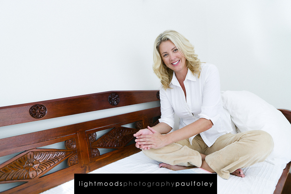 Smiling woman, looking to camera,sitting on couch