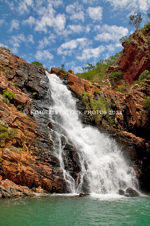 A waterfall at the Western end of Talbot Bay flows at the end of the Kimberley wet season.