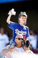 19 July 2009: Father and son fans with webkin promotion during the MLB Los Angeles Dodgers 4-3 win over the Houston Astros on a warm summer day in LA at Chavez Ravine during a National League Professional Baseball game.