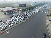 CHENGDU, CHINA - JANUARY 25: <br /> <br /> Spring Festival causes Traffic issues<br /> <br /> Aerial view of vehicles waiting to get out of Chengdu through the toll station on Chengdu-Ya\'an Expressway on January 25, 2017 in Chengdu, Sichuan Province of China. The Spring Festival travel peak bursts out ahead of Lunar New Year all over China. <br /> ©Exclusivepix Media