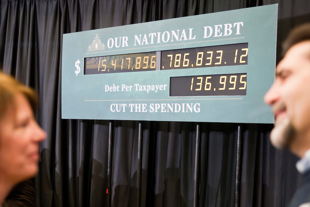 Lathan Goumas | MLive.com..February 25, 2012 - A clock that shows the national debt of the united states is desplayed at Kettering University in Flint where Republican presidential candidate Mitt Romney spoke on Saturday. During is remarks Romney discussed the climbing national debt and stated that if elected he would decrease the debt.