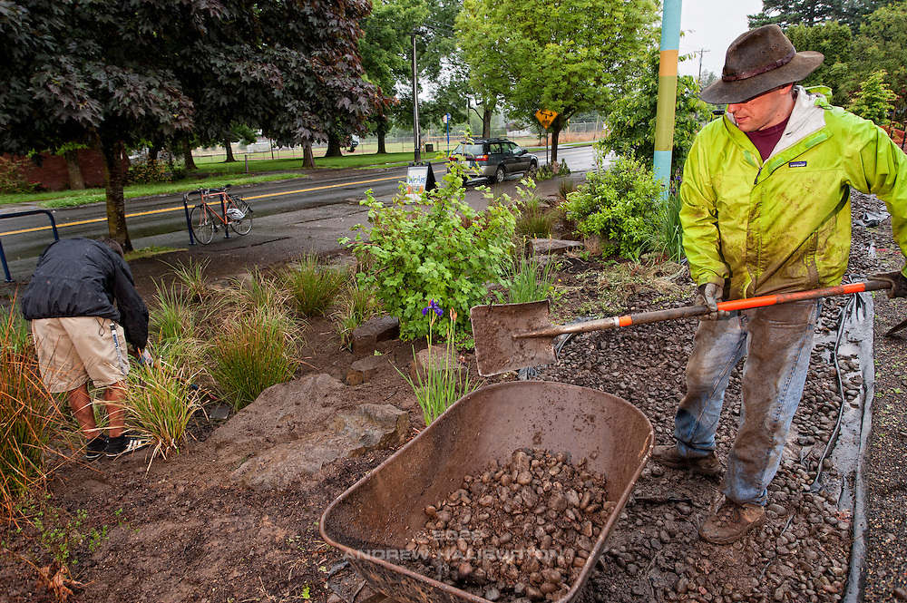 Adrian Lucas and Josh Lighthipe volunteer at the rain garden work meet, Café au Play at Tabor Commons, a project of the Southeast Uplift Neighborhood Coalition (SEUL) and volunteers from Portland's Mt Tabor neighborhood.