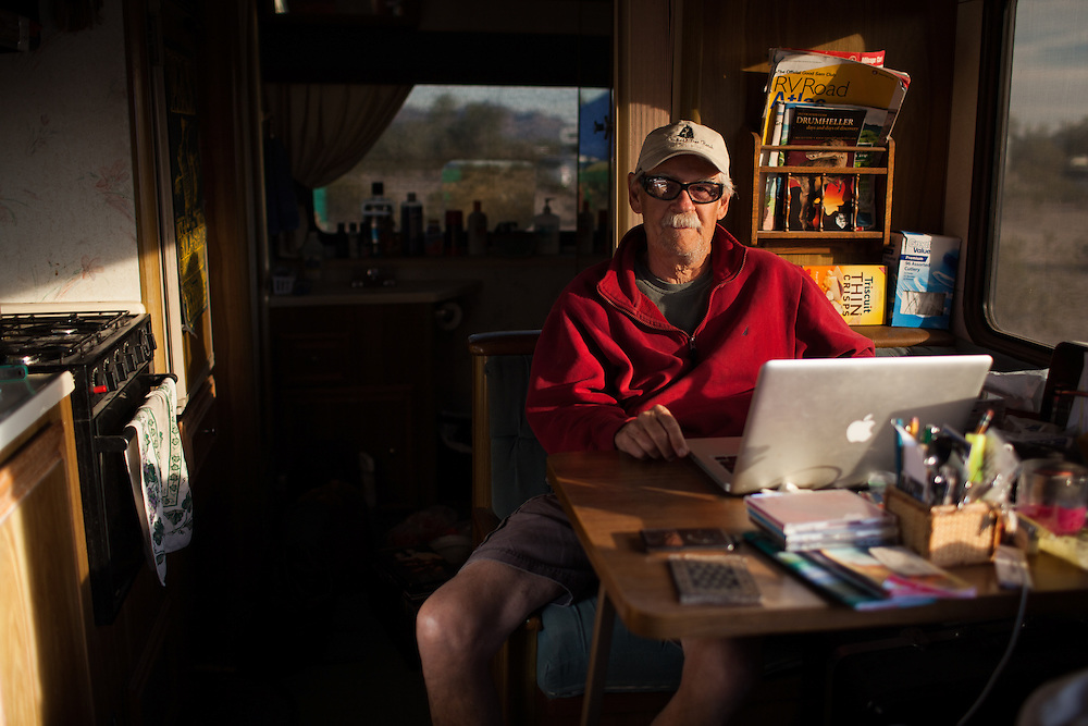 Workamper and blogger Jim Melvin poses for a portrait in his RV while camped in the desert outside Quartzite, Arizona.