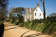Large detached house and sandy unsurfaced road, Island of Sark, Channel Islands, Great Britain