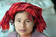 Myanmar. Woman at weekly market.
