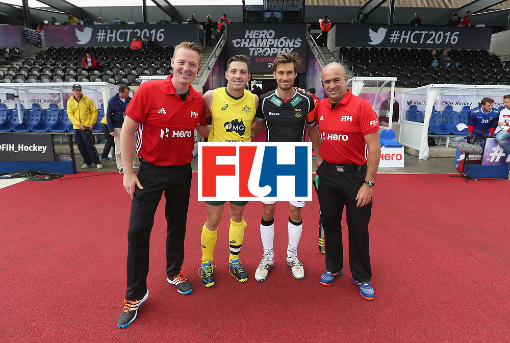 LONDON, ENGLAND - JUNE 13:  Simon Orchard of Australia and Tobias Fuchs of Germany with match officials prior to the FIH Mens Hero Hockey Champions Trophy match between Germany and Australia at Queen Elizabeth Olympic Park on June 13, 2016 in London, England.  (Photo by Alex Morton/Getty Images)