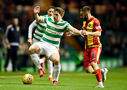 Celtic's James Forrest and Partick's Steven Lawless battle for the ball during the Scottish Premiership match at Celtic Park, Glasgow.