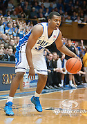 Duke guard Tyler Thorton looks for an opening. Duke beats UNC 79-73 at Cameron Indoor Stadium Durham NC