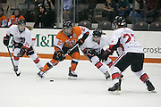 RIT Senior Captain Lindsay Grigg tries to break past defenders during an exhibition game at RIT's Gene Polisseni Center on Monday, September 29, 2014.