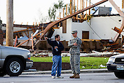 May 24, 2011- A resident talks with a Missouri National Guard member at the intersection of West 15th Street and Connecticut Avenue in Joplin, Missouri after a Tornado came through the town on Sunday, May 22, 2011. Credit: David Welker / TurfImages.com.