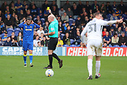 AFC Wimbledon defender George Francomb (7) yellow card during the EFL Sky Bet League 1 match between AFC Wimbledon and Northampton Town at the Cherry Red Records Stadium, Kingston, England on 11 March 2017. Photo by Matthew Redman.