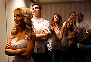 "Baltimore Ravens cheerleader hopefuls wait back stage to hear results during an event called ""Making the Cut"" to select the 2011 Baltimore Ravens cheerleaders in Baltimore, Maryland, March 26, 2011."