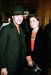 Top designer JOHN GALLIANO and top fashion editor SUSIE MENKES,  at a party in London on 8th May 1997.LYF 59