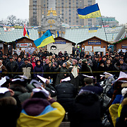 December 19, 2013 - Kiev, Ukraine: Pro-EU demonstrators listen to a activist speech in Independence Square.<br /> On the night of 21 November 2013, a wave of demonstrations and civil unrest began in Ukraine, when spontaneous protests erupted in the capital of Kiev as a response to the government&rsquo;s suspension of the preparations for signing an association and free trade agreement with the European Union. Anti-government protesters occupied Independence Square, also known as Maidan, demanding the resignation of President Viktor Yanukovych and accusing him of refusing the planned trade and political pact with the EU in favor of closer ties with Russia.<br /> After a days of demonstrations, an increasing number of people joined the protests. As a responses to a police crackdown on November 30, half a million people took the square. The protests are ongoing despite a heavy police presence in the city, regular sub-zero temperatures, and snow. (Paulo Nunes dos Santos/Polaris)
