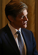 Staff Photo by Dan Henry / The Chattanooga Times Free Press- 8/17/16. Dr. Mehmet Oz performs media interviews before delivering his keynote address at a Children's Hospital event at the Embassy Suites on Wednesday, August 17, 2016.