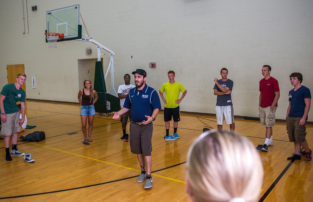 David Roth, first year OU grad student in recreation, leads a group of incoming freshman in ice breaker games at the Ping Center during Bobcat Student Orientation 2013.  July 18, 2013.  Photo by Elizabeth Held