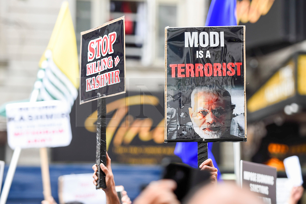 © Licensed to London News Pictures. 15/08/2019. LONDON, UK.  Signs held aloft as thousands of protesters, many waving Pakistani and Kashmiri flags, gather outside the Indian High Commission in Aldwych, on what they are calling Black Day, to stand in solidarity with the people of Kashmir.  Indian Prime Minister Narendra Modi delivered an Independence Day speech highlighting his decision to remove the special rights of Kashmir as an autonomous region.  Photo credit: Stephen Chung/LNP