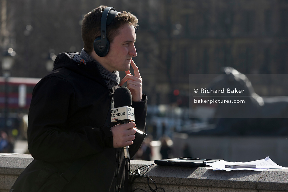 A BBC London 94.9 radio reporter, on location in Trafalgar Square after the unveiling of the Fourth Plinth artwork.