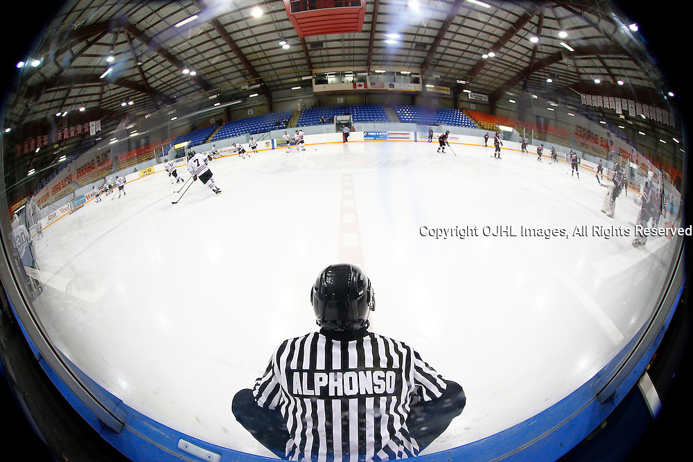 NEWMARKET, ON - Feb 4 : Ontario Junior Hockey League Game Action between the Stouffville Spirit and the Newmarket Hurricanes, Linesman Shandor Alphonso watches the teams during warm-up.<br /> (Photo by Brian Watts / OJHL Images)