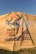 The FIFA World Cup logo on the construction site of Soccer City, the stadium venue for the 2010 South Africa FIFA World Cup in Johannesburg