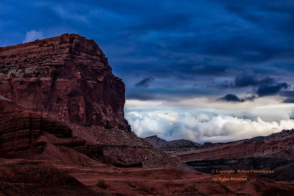 A very dramatic view of The Castle, a prominent outcropping of rock, set against a dynamic sky at sunset, Capital Reef National Park, Utah USA.<br />