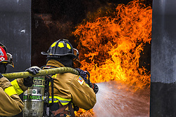 Apr 26, 2017 - Japan - Flame Force. Air Force Senior Airman ANTONIO HARMON and Tech. Sgt. MICHAEL GAGNIER fight a fire during training at Kadena Air Base, Japan, April 26, 2017. Harmon and Gagnier are firefighters assigned to the 18th Civil Engineer Squadron. Air Force photo by Senior Airman Nick Emerick. (Credit Image: ? Nick Emerick/Air Force/DoD via ZUMA Wire/ZUMAPRESS.com)