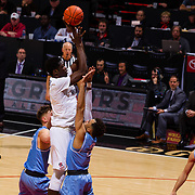05 December 2018: San Diego State Aztecs forward Aguek Arop (3) takes a jump shot in the paint over San Diego Toreros guard Olin Carter III (3) in the first half. The Aztecs lost to the Toreros 73-61 at Viejas Arena.