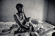 Rebecca Amok, 16, with 7 month old Yar. Rumbek, Western Lakes State, South Sudan.