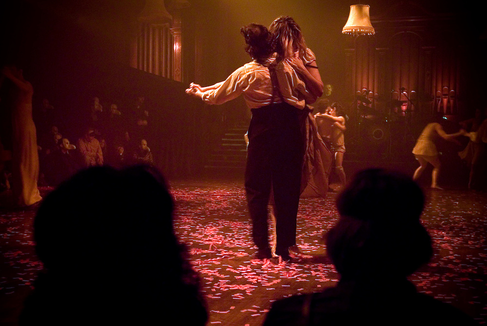 UK. London. Edgar Allan Poe's The Masque of the Red Death by Punchdrunk at The Battersea Arts Centre (BAC), an old local Town Hall, in Battersea in South West London..Photo shows the Grand Hall where the audience from the show are taken to after the show. There is a short dance show which then turns in to a party..Photo©Steve Forrest/Workers Photos