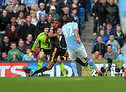 Carlos Tevez scores the winning goal past Chelsea's Petr Cech during the Barclays Premier League match between Manchester City and Chelsea at the City of Manchester Stadium on September 25, 2010 in Manchester, England.