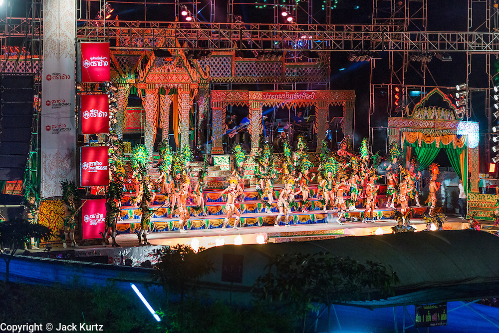 23 NOVEMBER 2013 - BANGKOK, THAILAND: The stage of the Prathom Bunteung Silp mor lam troupe during a performance in Bangkok. Mor Lam is a traditional Lao form of song in Laos and Isan (northeast Thailand). It is sometimes compared to American country music, song usually revolve around unrequited love, mor lam and the complexities of rural life. Mor Lam shows are an important part of festivals and fairs in rural Thailand. Mor lam has become very popular in Isan migrant communities in Bangkok. Once performed by bands and singers, live performances are now spectacles, involving several singers, a dance troupe and comedians. The dancers (or hang khreuang) in particular often wear fancy costumes, and singers go through several costume changes in the course of a performance. Prathom Bunteung Silp is one of the best known Mor Lam troupes in Thailand with more than 250 performers and a total crew of almost 300 people. The troupe has been performing for more 55 years. It forms every August and performs through June then breaks for the rainy season.              PHOTO BY JACK KURTZ