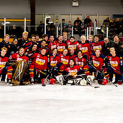 AURORA, ON - APR 8,  2018: Ontario Junior Hockey League, North East Conference Championship Series. Game five of the best of seven series between the Wellington Dukes and the Aurora Tigers. Wellington Dukes pose for a team picture after there championship win.<br /> (Photo by Spencer Smye / OJHL Images)