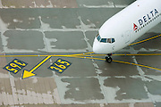 Aerial view (from control tower) of Delta airliner at London Heathrow airport.
