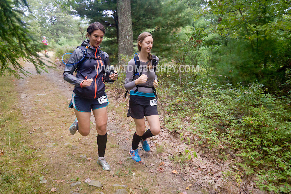 Kerhonkson, New York - Jenna Tomiello, left, and Laura Merner move through Minnewaska State Park Preserve during the Shawangunk Ridge Trail Run/Hike 20-mile race on Sept. 20, 2014.