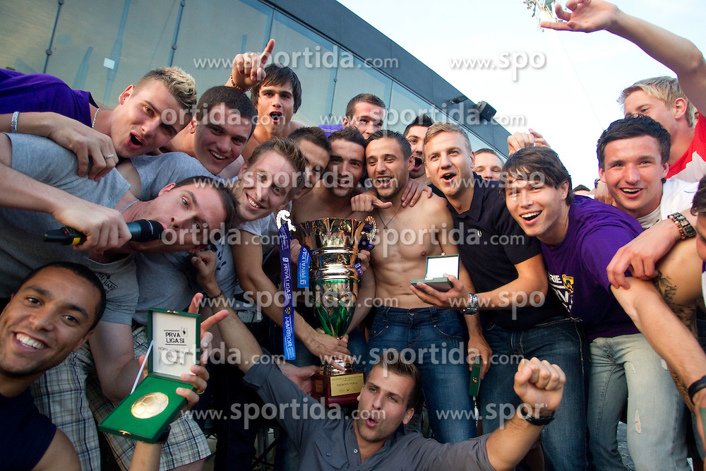 Players of Maribor celebrate at Trophy ceremony after the football match between NK Maribor and NK Domzale of 36th - Last Round of 1st Slovenian football league PrvaLiga, on May 29, 2011 in Stadium Ljudski vrt, Maribor, Slovenia. (Photo By Vid Ponikvar / Sportida.com)
