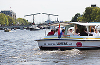 AMSTERDAM - Varen in rondvaartboot van Lovers op de Amstel met Magere Brug.  ANP COPYRIGHT KOEN SUYK