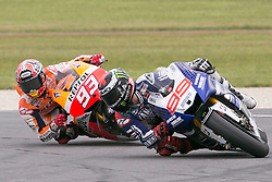 © Licensed to London News Pictures. 20/10/2012. Jorge Lorenzo (SPA) riding for the Yamaha Factory Racing leading Marc Marquez (SPA) riding for the Repsol Honda Team during the Race day of the round 16 2013 Tissot Australian Moto GP at the  Phillip Island Grand Prix Circuit Victoria, Australia. Photo credit : Asanka Brendon Ratnayake/LNP