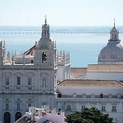 A view of Monastery of São Vicente de Fora from the ramparts of Castelo de Sao Jorge. Sitting high on a hill overlooking the center of Lisbon, São Jorge Castle (or Castelo de São Jorge or Saint George Castle) is a Moorish castle. Fortifications have existed on the site for thousands of years, and the current distinctive walls date to the 14th century.