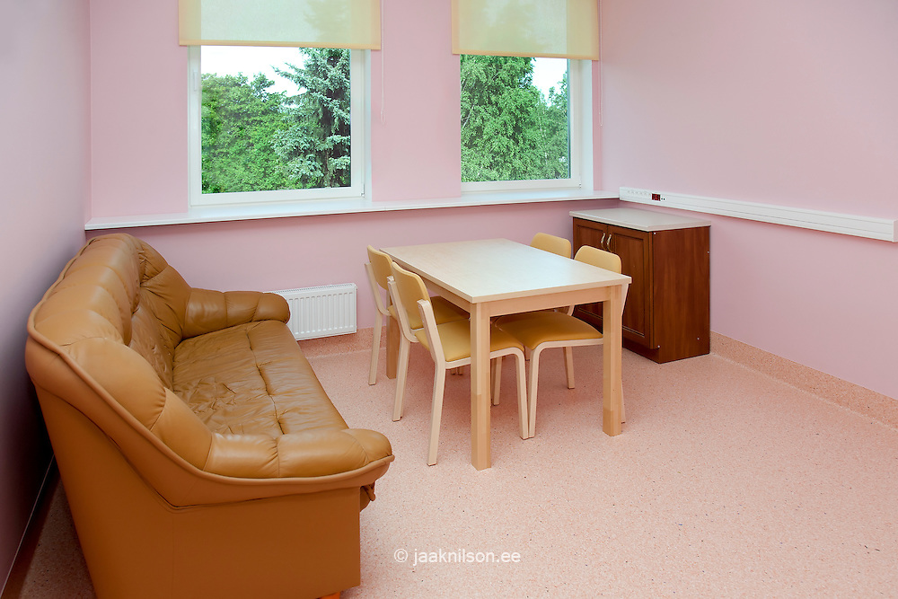 hospital waiting room with table and couch