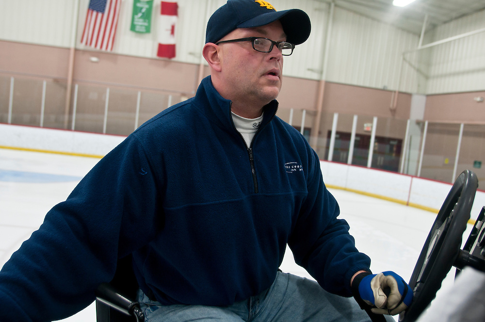 Lathan Goumas | The Bay City Times..Dave Gill, assistant manager at the Bay County Civic Arena in Bay City, MI., drives an ice resurfacer in an ice rink on Thursday December 15, 2011.